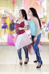 Two young girls shopping together