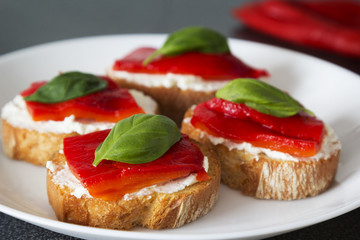Canapes with roasted peppers, cream cheese and basil