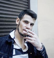 middle age man smoking cigarette on backjard, stylish tough guy, lifestyle people concept