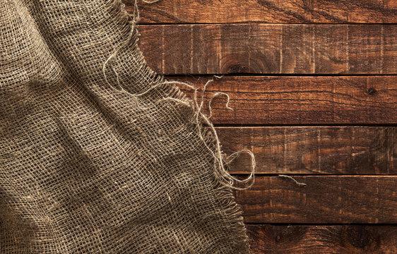 Burlap texture on wooden background