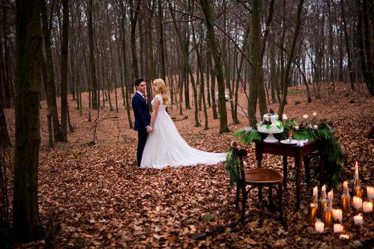 Romantic wedding faitytale in autumn forest