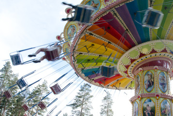 Kouvola, Finland 7 June 2016 - Ride Swing Carousel in motion in amusement park Tykkimaki