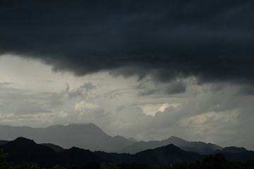 Strom and big black cloud over mountain