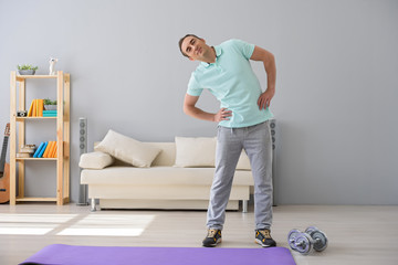 Adult man doing exercises at home