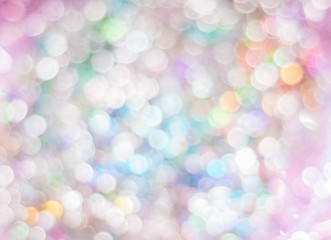 Blurred background with bokeh lights in pastel colours