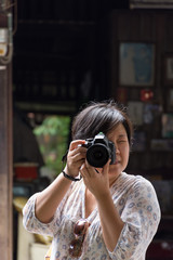 Asia woman take a photo by camera
