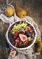 Chocolate coffee cake decorated fresh fruits