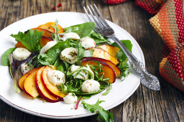 Peach and marinated mozzarella salad with fresh mixed greens