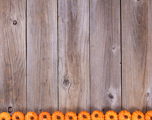Bottom border of autumn holiday pumpkin decorations