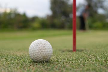 Golf ball lip of hole on green