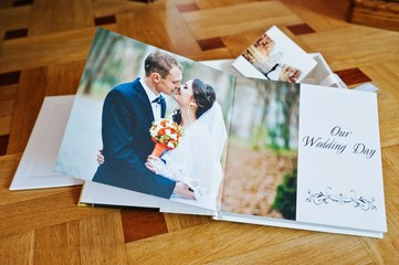 White leather wedding book or wedding album on wooden background