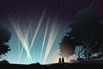 couple watching concert in the forest