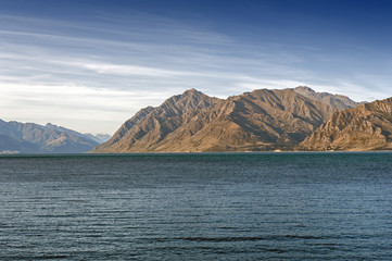 Lake Hawea located in the Otago Region of New Zealand is a popular resort, and is well used in the summer for fishing, boating and swimming