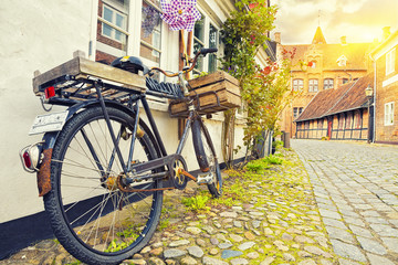 Vintage Bicycle On House Wall At Sunset, Old Town Street,