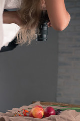 Photographer girl at work shooting still life
