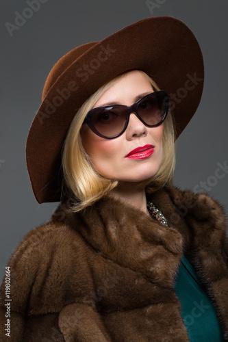 23c9e16b0d Beautiful mature woman in natural fur coat