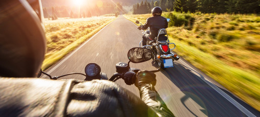 Motorcycle drivers riding on motorway