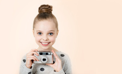 Little girl taking picture. Kid and camera. Photography classes.