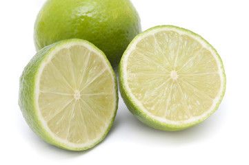 Halved and whole fresh limes