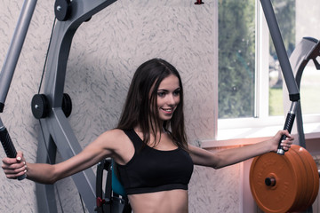 The girl is engaged in the gym