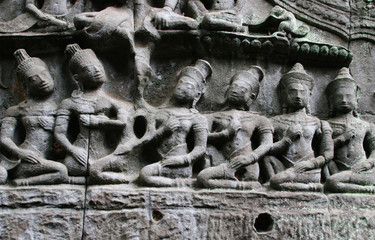 Stone carvings at the wall of Ta Prohm, Angkor Area, Siem Reap, Cambodia