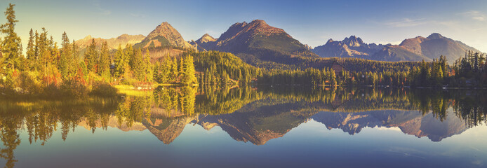 High resolution panorama of the lake in Strbske Pleso,High Tatras,Slovakia.Toned with a retro vintage  effect