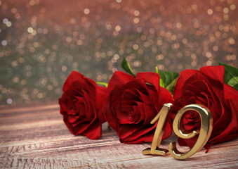 birthday concept with red roses on wooden desk. nineteenth. 19th. 3D render