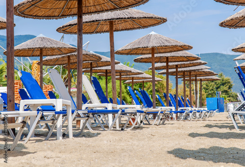 Row Of Sunbeds And Towels At A Beach Resort Stock Photo And