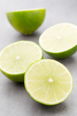 Juicy ripe lime an gray table.