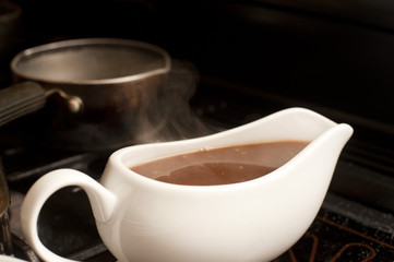 Gravy boat filled with delicious rich gravy