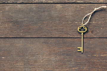 old key on wood background with copyspace.