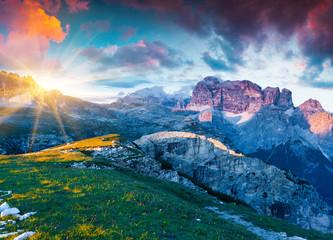 Colorful summer sunrise on Gruppo del Cimonega mountain range