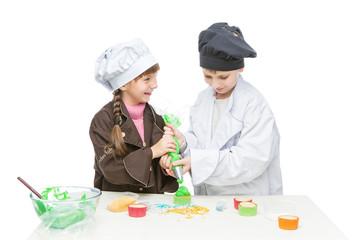 Children making christmas cupcakes