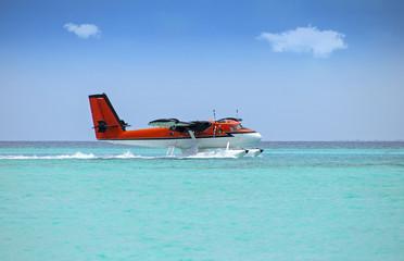 seaplane soft landing on turquoise ocean