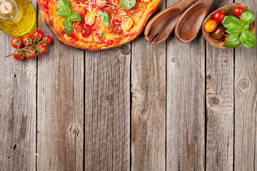 Pizza with tomatoes, mozzarella and basil
