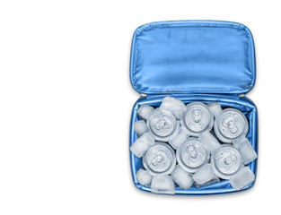 Soft cooler bag with soda cans and ice cubes, isolated, top down view
