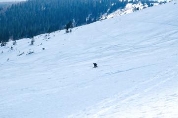 man ski free ride downhill at winter season in shadow on beautiful sunny day