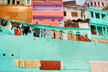 Indian homes of poor people with balconies and laundry drying in Varanasi