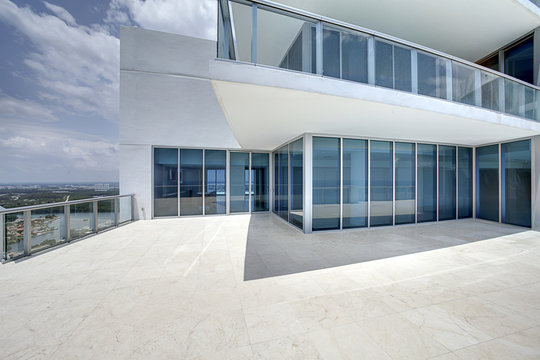 Modern balcony in luxury penthouse with Ocean view.