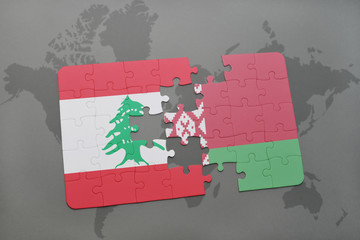 puzzle with the national flag of lebanon and belarus on a world map background.