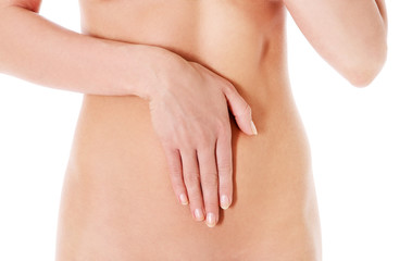 Body care, pregnancy diet concept, woman holding hands on the stomach.