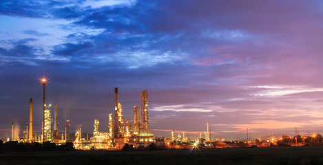 oil refinery, fuel manufacturer with beautiful sunrise or twilig