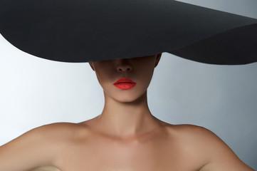 fashion beautiful woman in big hat