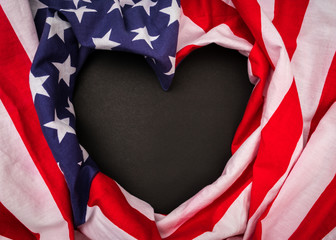 Heart shape American flag on black background .