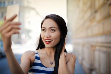 Beautiful girl doing a selfie