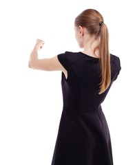 skinny woman funny fights waving his arms and legs. Isolated over white . Blonde in a short black dress punches.