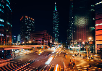 Traffic on Xinyi Road and view of Taipei 101 at night, in Taipei