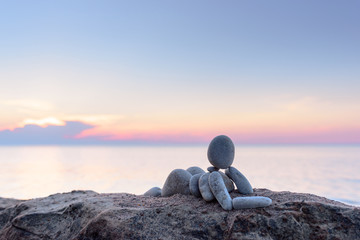 Statuette on morning beach