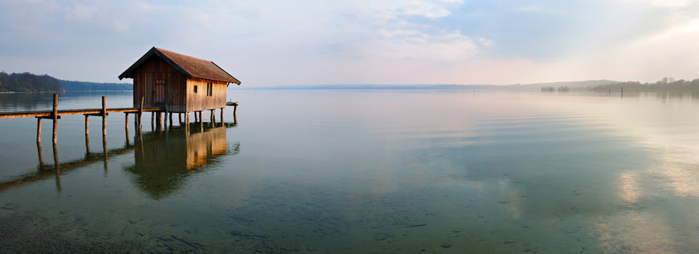 Fishing Hut by Calm Lake at Sunset, Clouds Reflecting in the Water, Ammersee, Bavaria