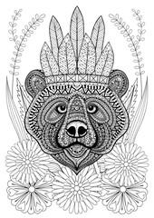 Zentangle stylized bear with war bonnet on flowers. Hand drawn e